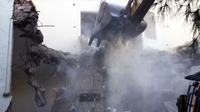 Destroying Old House With Bulldozer Mechanical Arm