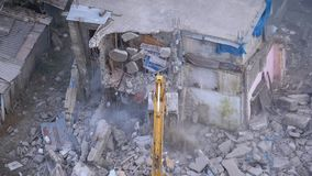 Destroying Old House Using Bucket Excavator on Construction Site. Slow Motion