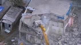 Destroying Old House Using Bucket Excavator on Construction Site. Timelapse