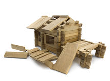Destructed house. Isolated wooden destructed toy house view Stock Photography
