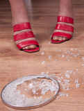 Destruction. Woman`s legs on the floor with small kitchen destruction royalty free stock photo