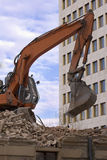 Destruction. Made by excavator with new building in background stock photos