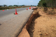 Destruction of asphalt highways road after hard rain storm and f. Lood water past stock photography