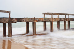 Destruction of bridge from sea wave Royalty Free Stock Images