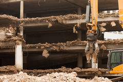 Destruction of concrete building with equipment Royalty Free Stock Photo