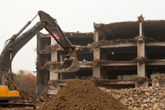 Destruction of concrete building with equipment Stock Photo
