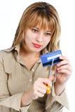 Destruction de jeune femme par la carte de crédit Photos stock