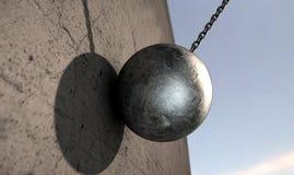 Destruction de la boule frappant le mur Image stock