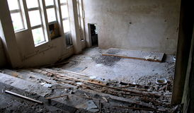 Destruction of education. Completely ruined lecture hall in soviet union school stock photography