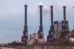 Destruction of the environment. Smokestacks of a chemical plant stock image
