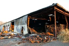 The destruction of fire 02. The debris of a warehouse factory building after a fire stock image
