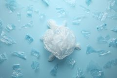 The destruction of ocean life, turtle from plastic trash royalty free stock images
