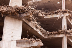 Destruction of old iron rebar concrete building Stock Photos