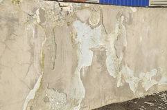 Destruction of plaster on the facade of an industrial building Royalty Free Stock Photos