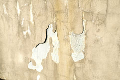 Destruction of plaster on the facade of an industrial building Stock Photos