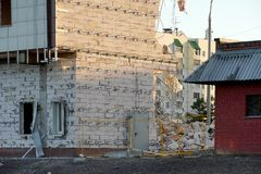 Destruction of several floors of the house. The wall of the foam block is partially broken. No windows, fence from the. Fence royalty free stock images