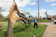 Destruction After Tornadoes Hit Saint Louis. SAINT LOUIS, MO – APRIL 22: Clean up after the destruction left behind by tornadoes that ravaged the area. April Royalty Free Stock Photography