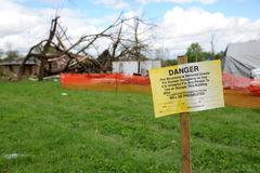 Destruction After Tornadoes Hit Saint Louis. SAINT LOUIS, MO – APRIL 22:Sign in front of destruction left behind by tornadoes that ravaged the area. April 22 Royalty Free Stock Images