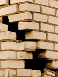 Destruction of a wall from a brick Stock Images