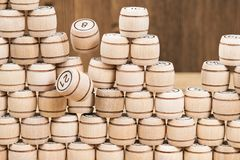 Destruction of the wall from wooden barrels. Destruction of the wall of wooden barrels from the bingo games have been laid out in a row Royalty Free Stock Image