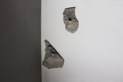 Destruction of a white wall. Stock Photos