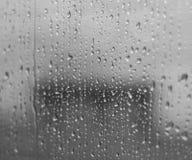 Deszcz krople na okno Fotografia Stock