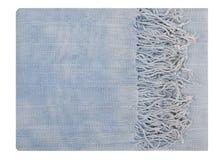 Det är en blå halsduk med frans. royaltyfri bild