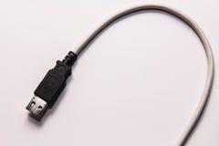 Det är en USB kabel som ej längre används Arkivfoton