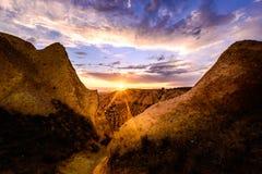 Det är om den röda dalsolnedgången, Cappadocia Royaltyfria Bilder