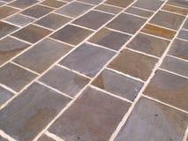det abstrakt golvet kritiserar tegelplattan Arkivbilder