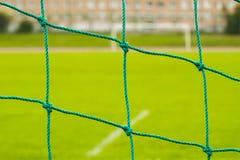 Det abstrakta fotbollmålet förtjänar modellen royaltyfria bilder