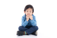 Det asiatiska barnet får borrat royaltyfria foton