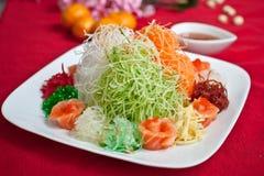 Det asiatiska välstånddugget, Lohei, Yusheng, yee sjöng Royaltyfri Foto