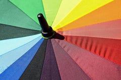Det avslöjda ljusa färgrika paraplyet Royaltyfri Bild