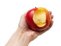 Det bet äpplet räcker in arkivfoto