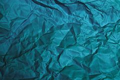 Det blåa arket skrynklade pappers- texturer för bakgrunden arkivfoto