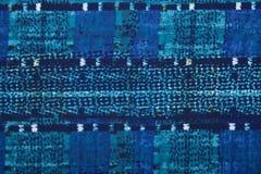 Det blåa materialet i abstrakta modeller Royaltyfri Fotografi