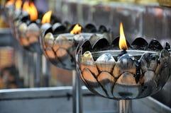 Flamma av det brinna stearinljuset Arkivbild