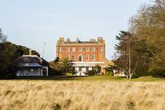 Det buskiga huset, den stora herrgården i buskigt parkerar, UK Royaltyfri Fotografi