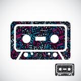 Det dekorativa färgrika symbolet för vektorkassettbandet fyllde med musi Royaltyfri Foto