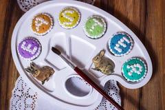 Det Eastercookies palettalfabetet uttrycker greetingcards Royaltyfria Bilder