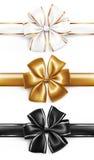 Det eleganta guld-, vit- och svartbandet bugar Arkivfoto