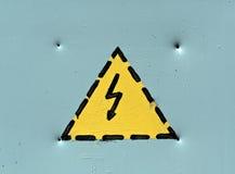 Det elektriska nöd- varningstecknet på grå färger belägger med metall sureface Arkivbilder