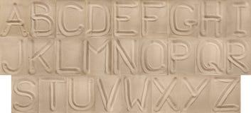 Det engelska alfabetet från sanden Royaltyfria Bilder