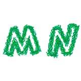Det engelska alfabetet som göras med gräsplansidor, sommartema, märker M N Arkivbild
