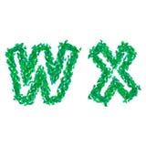 Det engelska alfabetet som göras med gräsplansidor, sommartema, märker W X Arkivbild