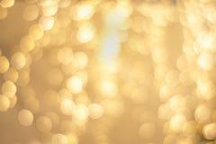 Det exklusiva höga slutet som är guld-, jul semestrar oskarpa ljus för bakgrund festligt härligt royaltyfri fotografi