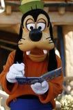 Det fåniga tecknet undertecknar på Disneyland arkivfoton