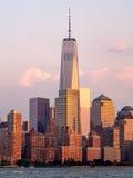 Det finansiella området i New York City på solnedgången Royaltyfri Fotografi