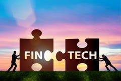 Det finansiella teknologibegreppet för fintech med pusselstycken Royaltyfria Bilder